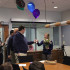 Brittany Fore, language arts teacher, receives flowers and balloons from the administration as they  announce her selection as MHS's teacher of the year on Monday, Feb. 24.