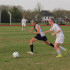 Mia Schweain, junior, dribbles past her defender.