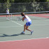 Hetty Bai, senior, competes against a Ladue player in a varsity tennis game.