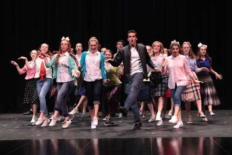 Theater students coming together during tech week for Bye Bye Birdie production