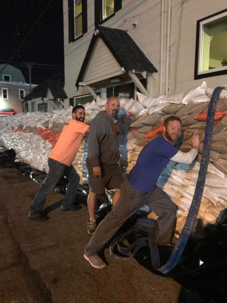 Dr.+Greg+Mathison%2C+principal%2C+stands+in+front+of+the+sandbag+wall+in+Eureka.+Mathison+and+other+Eureka+residents+have+been+working+to+build+the+wall+since+rain+started+on+Saturday%2C+April+29.