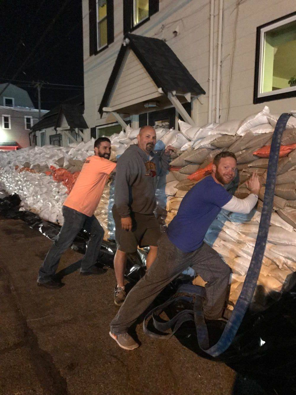 Dr. Greg Mathison, principal, stands in front of the sandbag wall in Eureka. Mathison and other Eureka residents have been working to build the wall since rain started on Saturday, April 29.