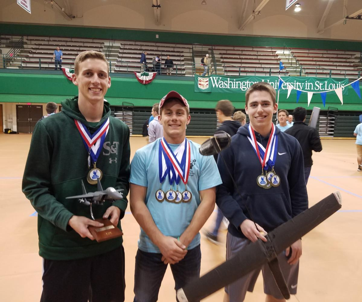 Left to right: Alex Myers, JT Schuman, and Daniel Swegle, seniors, pose after winning the annual Boeing Engineering Challenge. They placed first out of the teams in their division.