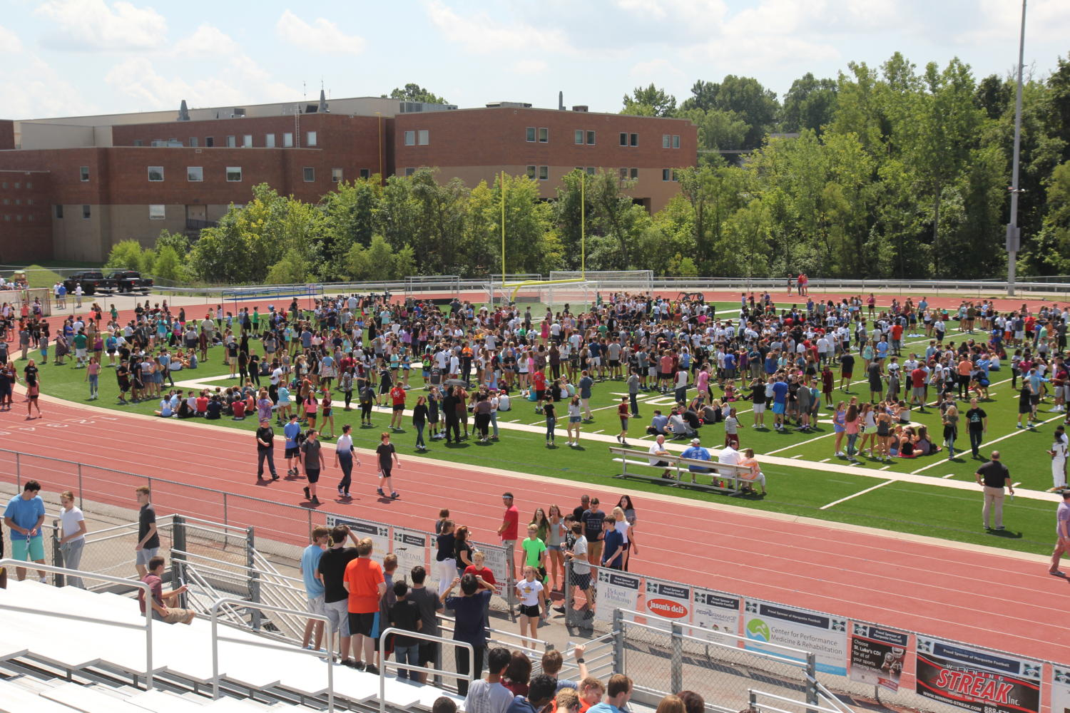 Students+wait+patiently+in+the+sports+field+for+the+the+total+eclipse.+Over+1%2C800+students+crowded+the+field+Tuesday+afternoon.