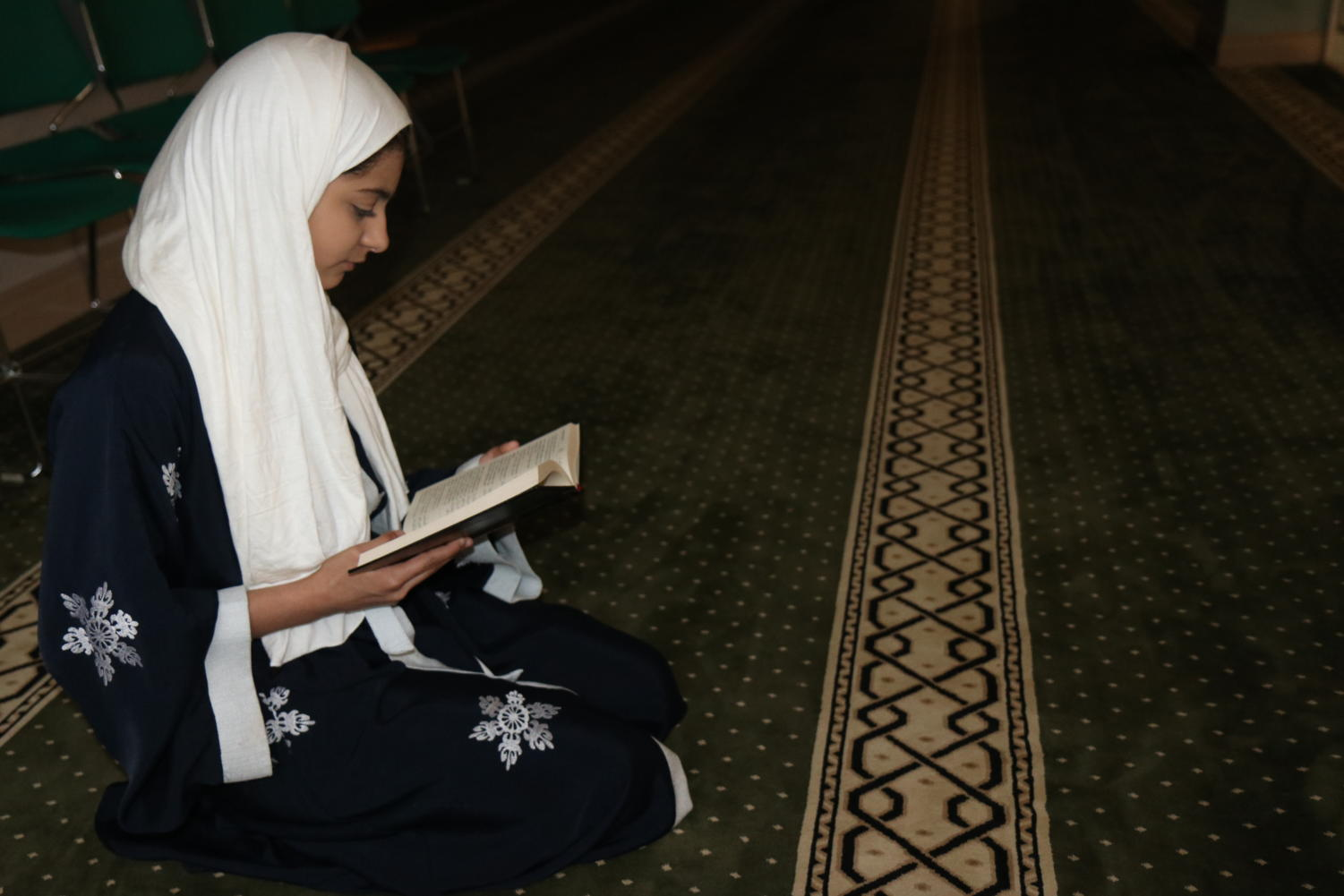 Lana Megdad, sophomore, reads the Quran at the Dar Ul-Islam mosque.